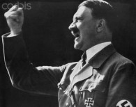 ca. 1939, Germany --- Defiant Adolf Hitler --- Image by © Bettmann/CORBIS